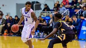 Hofstra Pride guard Justin Wright-Foreman sizes up Towson