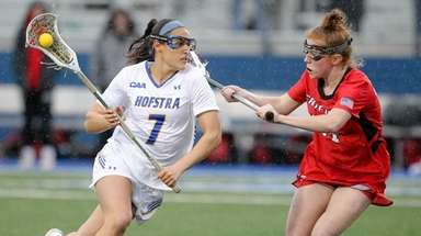Hofstra's Alyssa Parrella (7) takes that ball to