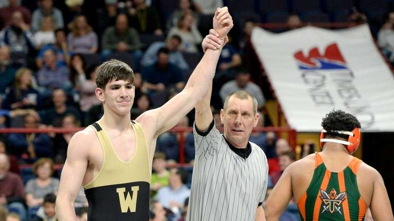 Wantagh's Jonathan Loew celebrates his win over East