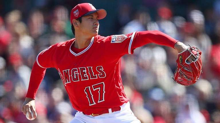 The Angels' Shohei Ohtani works against the Brewers