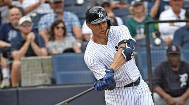 Giancarlo Stanton takes a swing during his