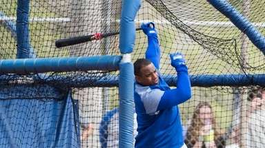 Yoenis Cespedes takes batting practice during a