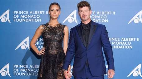 April Love Geary and Robin Thicke attend a