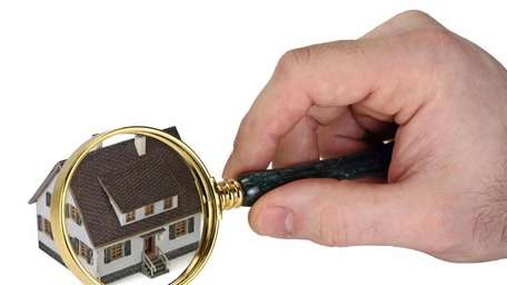 Concept image of a home inspection. A male