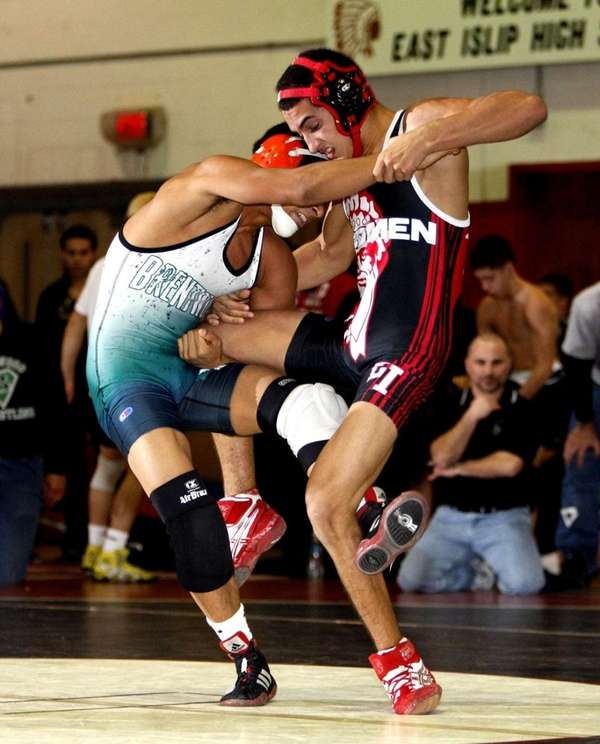 East Islip's Nick Ventiere, right, wrestles Brentwood's Alex