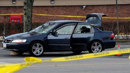 Investigators arrive at the scene where police shot