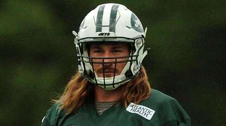 Jets' Dylan Donahue watches a play during training