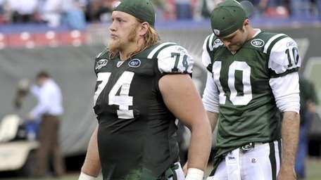 Jets center Nick Mangold, left, says Mark Sanchez's