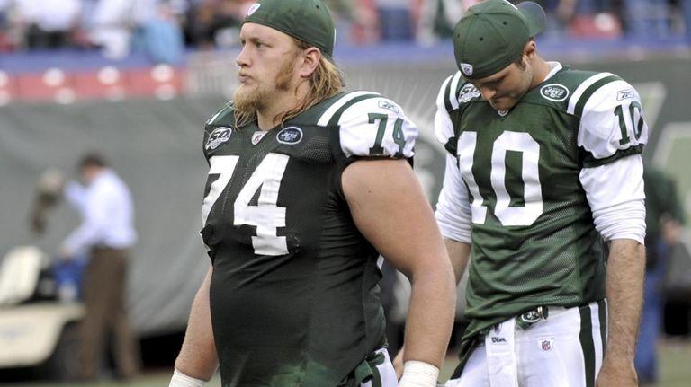 Jets center Nick Mangold, left, says Mark Sanchez's
