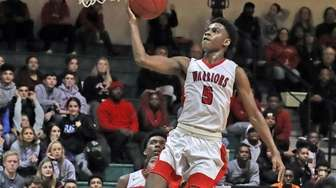 Amityville's Jayson Robinson #5 goes up for a