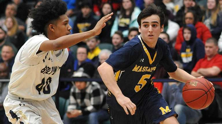 Nicholas Schneidler #5 of Massapequa, right, gets pressured