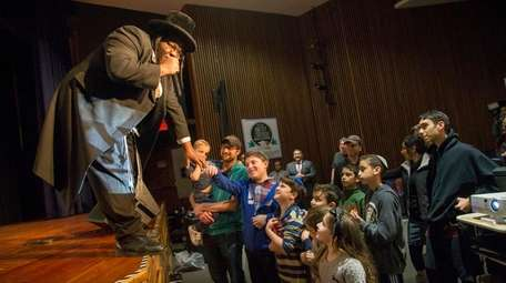 Hasidic rapper Nissim Back performs at a unity