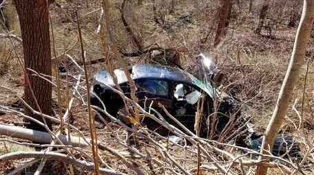 A car struck a guardrail on Route 25A