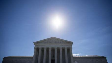 The sun shining above the U.S. Supreme Court