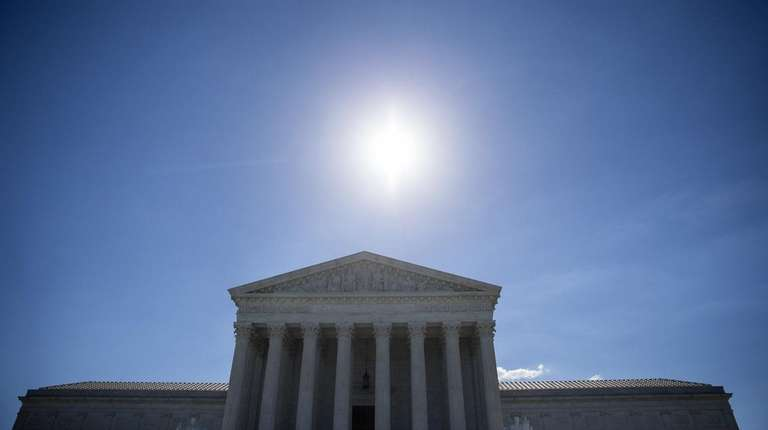 The sun shining above the U.S. Supreme Court