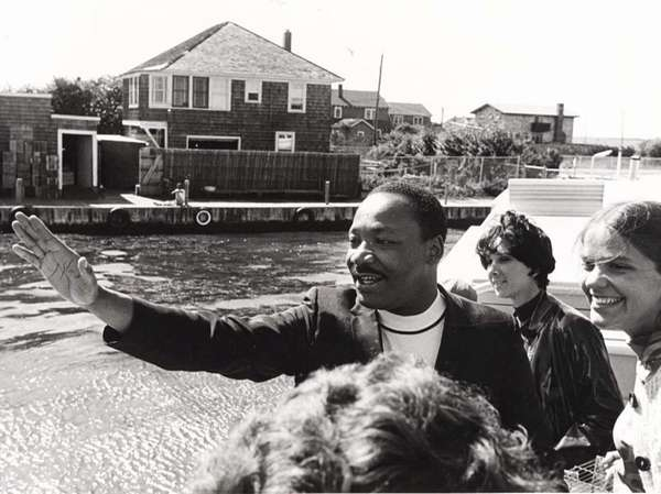 Dr. Martin Luther King waves from the ferry