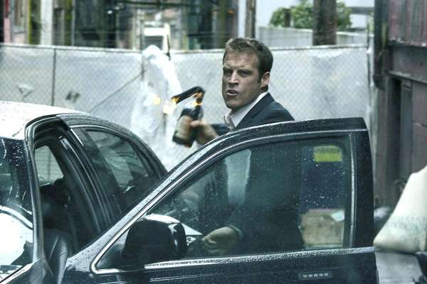 Christopher Chance (Mark Valley) is the human target,