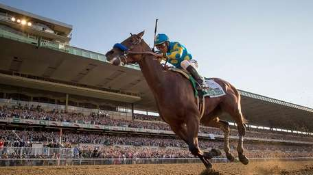 American Pharoah winning the triple crown in the