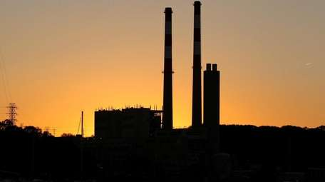 LIPA power plant towers are seen at sunset