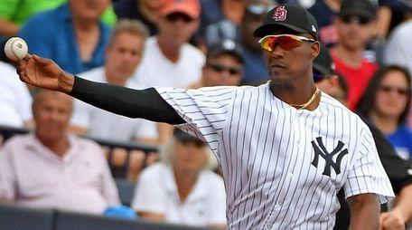 Yankees third baseman Miguel Andujar makes a play