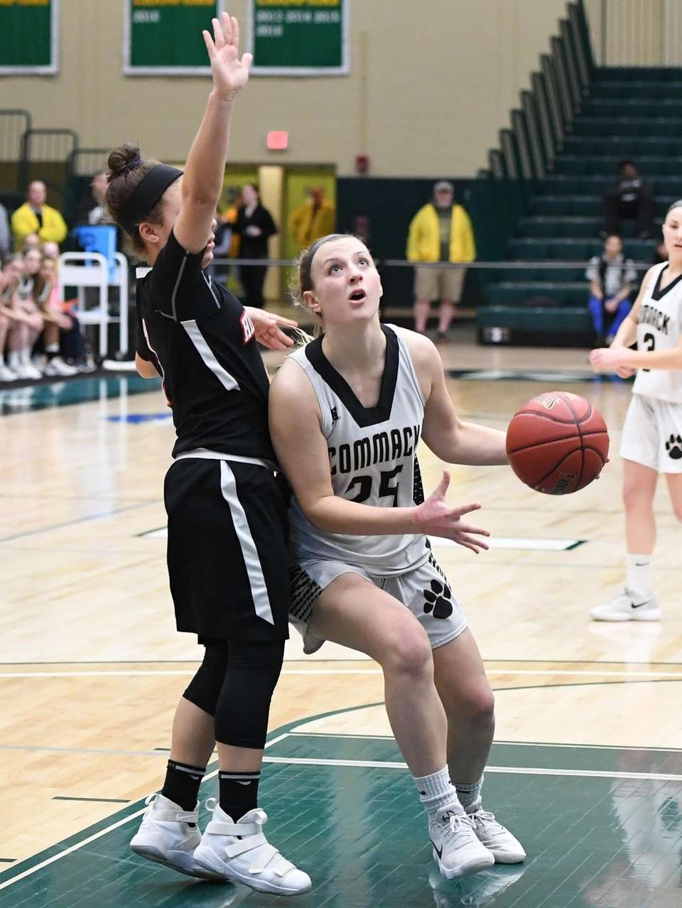 Commack forward Lauren Maline looks to shoot defended