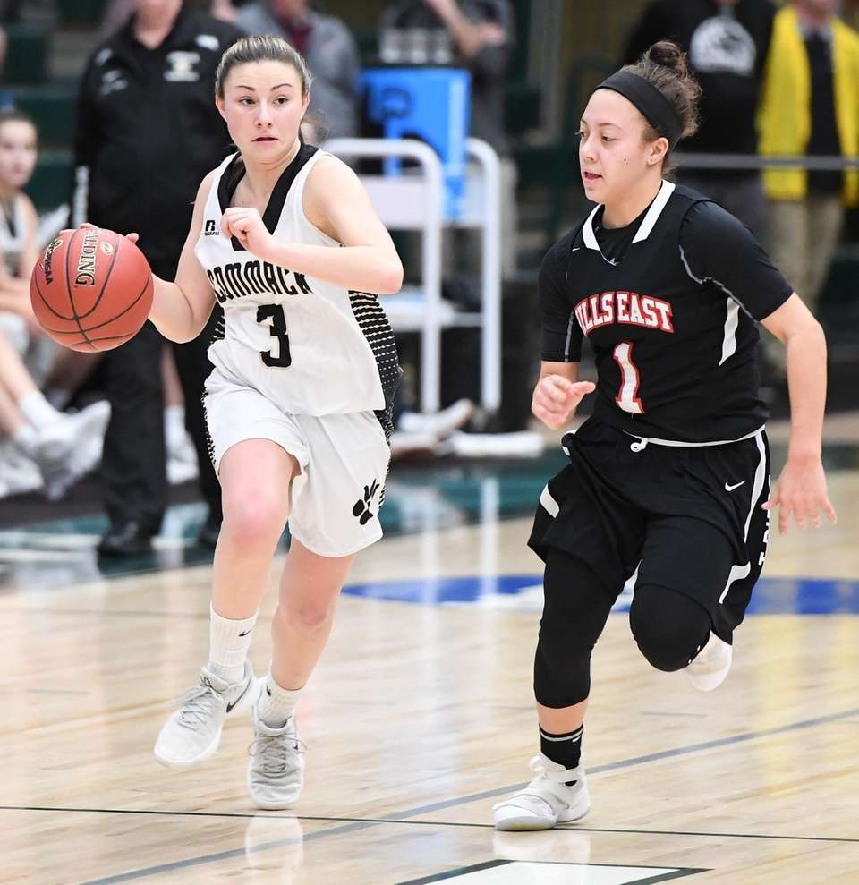 Commack guard Katie Kelly dribbles the ball up
