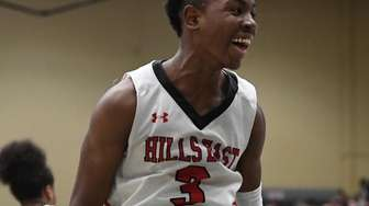Half Hollow Hills East's Savion Lewis reacts against