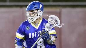 Hofstra's Jimmy Yanes drives from behind the net