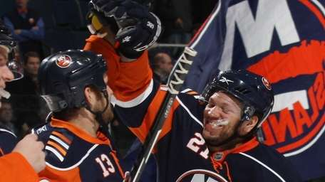 The Islanders' Rob Schremp, left, and Kyle Okposo