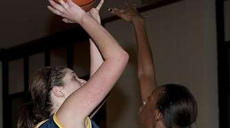 Northport's Stephanie Leon goes up and over Whitman's