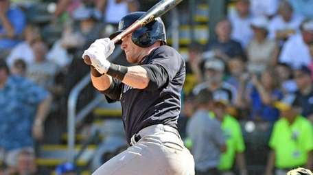 Yankees outfielder Clint Frazier hits a single during
