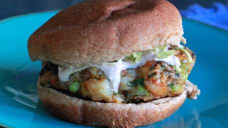 Shrimp with cajun seasonings is made into burgers