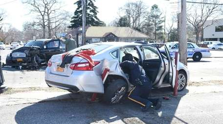 An officer searches a vehicle that officials said