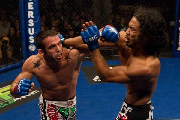 Ben Henderson, right, secured a flying guillotine choke