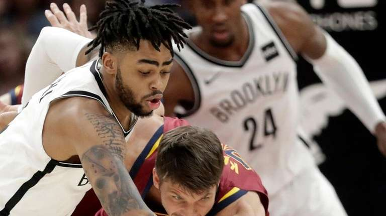 The Nets' D'Angelo Russell, left, and the Cavaliers'