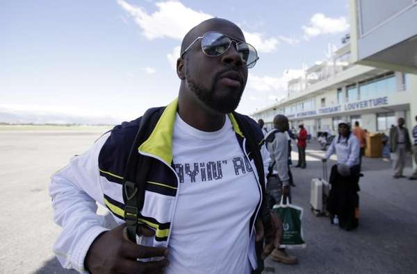 Haiti's Musician Wyclef Jean arrives at the airport