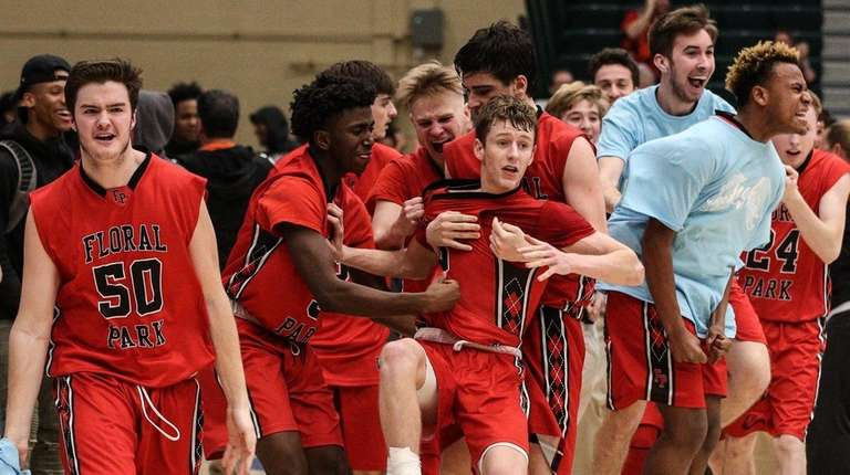 Floral Park celebrates their 57-56 win over Sewanhaka