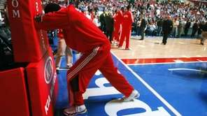 Philadelphia 76ers' Samuel Dalembert stretches before a game