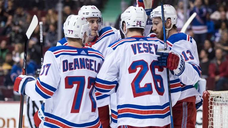 The Rangers' Anthony DeAngelo, Rob O'Gara, Jimmy Vesey