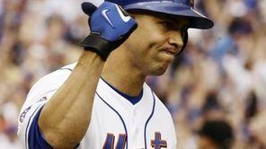 New York Mets' Carlos Beltran celebrates after hitting