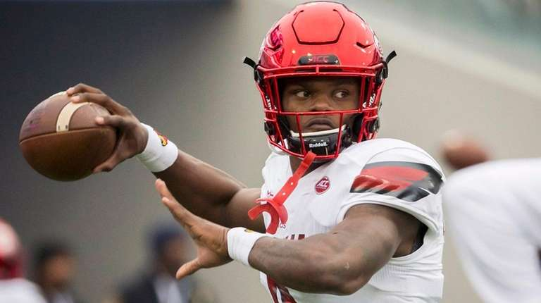 Louisville quarterback Lamar Jackson before the Tax Slayer Bowl