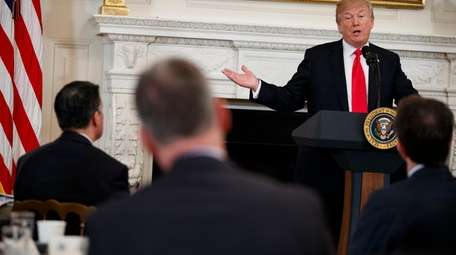 President Donald Trump speaks during a meeting with