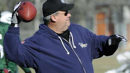New York Jets coach Rex Ryan throws a