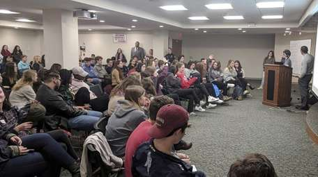 Students, parents and community members attend a forum