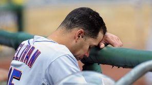New York Mets' Carlos Beltran hangs his head