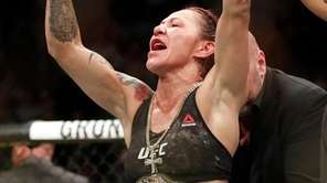 Cris Cyborg celebrates after defeating Holly Holm during