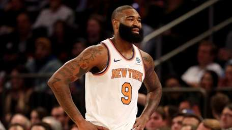 Kyle O'Quinn of the Knicks reacts after he