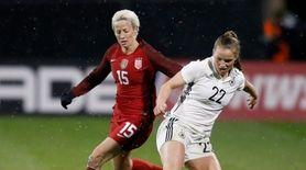 Germany midfielder Tabea Kemme (R) controls the ball