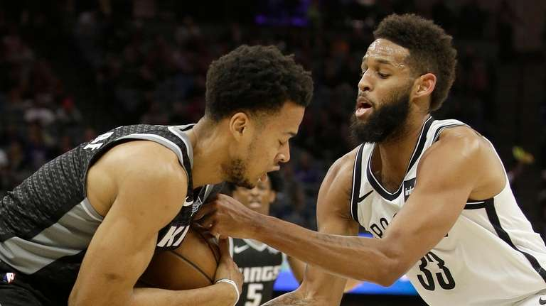 Nets guard Allen Crabbe, right, tries to pull