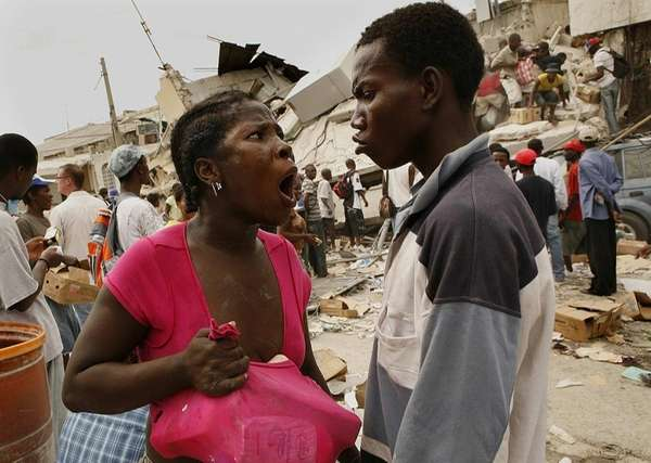 A man and women argue over looted goods